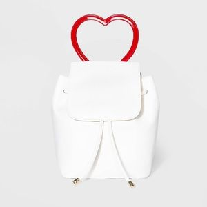 Mini flap backpack with heart handle
